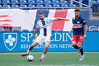 FOXBOROUGH, MA - JULY 4: Evan Lee #12 of Greenville Triumph SC passes the ball near the Greenville Triumph SC goal during a game between Greenville Triumph SC and New England Revolution II at Gillette Stadium on July 4, 2021 in Foxborough, Massachusetts.