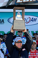 Chip Ganassi lifts the Prototype winner's trophy for the 3rd year in a row.