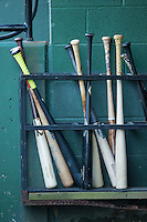 Baseball bats sit in the bat rack in the Kannapolis Intimidators dugout during the game against the Hagerstown Suns at Kannapolis Intimidators Stadium on May 4, 2016 in Kannapolis, North Carolina.  The Intimidators defeated the Suns 7-4.  (Brian Westerholt/Four Seam Images)