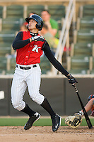 Trayce Thompson #24 of the Kannapolis Intimidators watches the flight of the first of his 2 home runs against the Delmarva Shorebirds at Fieldcrest Cannon Stadium May 12, 2010, in Kannapolis, North Carolina.  Photo by Brian Westerholt / Four Seam Images