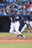 Asheville Tourists right fielder Randy Reyes (22) swings at a pitch during game one of a double header against the Greenville Drive on April 18, 2015 in Asheville, North Carolina. The Tourists defeated the Drive 2-1. (Tony Farlow/Four Seam Images)