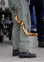 A British helicopter pilot with a tiger tail on his uniform during Tiger Air show.  Nato Tiger Meet is an annual gathering of squadrons using the tiger as their mascot. While originally mostly a social event it is now a full military exercise. Tiger Meet 2012 was held at the Norwegian air base Ørlandet.