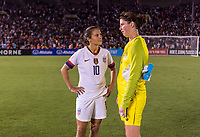 PASADENA, CA - AUGUST 4: Carli Lloyd #10 talks with Marie Hourihan #1 during a game between Ireland and USWNT at Rose Bowl on August 3, 2019 in Pasadena, California.