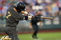 Vanderbilt Commodores shortstop Dansby Swanson (7) swings the bat during the NCAA College baseball World Series against the Cal State Fullerton Titans on June 14, 2015 at TD Ameritrade Park in Omaha, Nebraska. The Titans were leading 3-0 in the bottom of the sixth inning when the game was suspended by rain. (Andrew Woolley/Four Seam Images)
