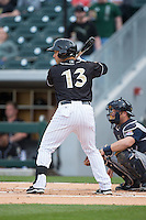 Carlos Sanchez (13) of the Charlotte Knights at bat against the Toledo Mud Hens at BB&T BallPark on April 27, 2015 in Charlotte, North Carolina.  The Knights defeated the Mud Hens 7-6 in 10 innings.   (Brian Westerholt/Four Seam Images)