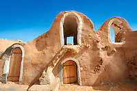 The northern Sahara ghorfa storage graneries of the traditional Berber mud brick fortified Ksar of Hedada or Hadada, near Tetouin, Tunisia, the setting of Mos Espa's Slave Quarters in Star Wars: Episode I The Phantom Menace.