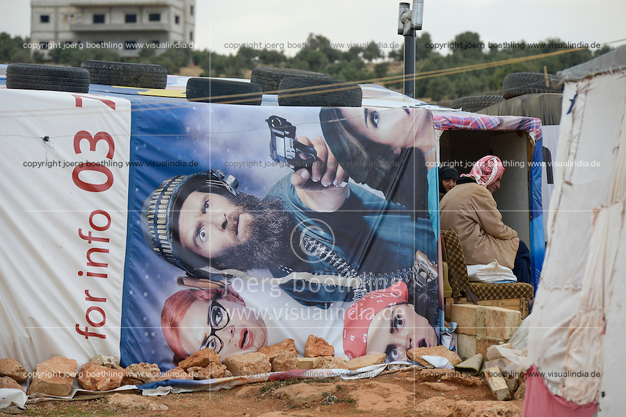 LEBANON Beqaa valley, Deir el Ahmad, camp for syrian refugees, family in tent made from old cinema poster / LIBANON Bekaa Tal, Deir el Ahmad, Camp fuer syrische Fluechtlinge am Dorfrand, Familie im Zelt aus alten Kinoplakaten
