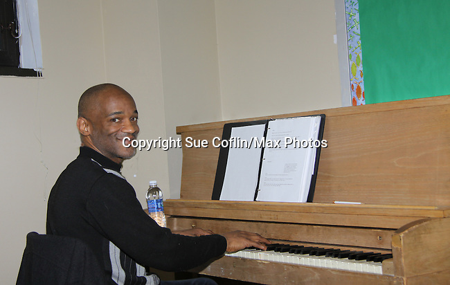 "Charles Lovell plays the piano at Grandparents Around the World, presents Evern's  new play ""To Do List"" in a first play reading on December 7, 2013 at the Salvation Army Harlem Corps, New York, New York.  (Photo by Sue Coflin/Max Photos)"