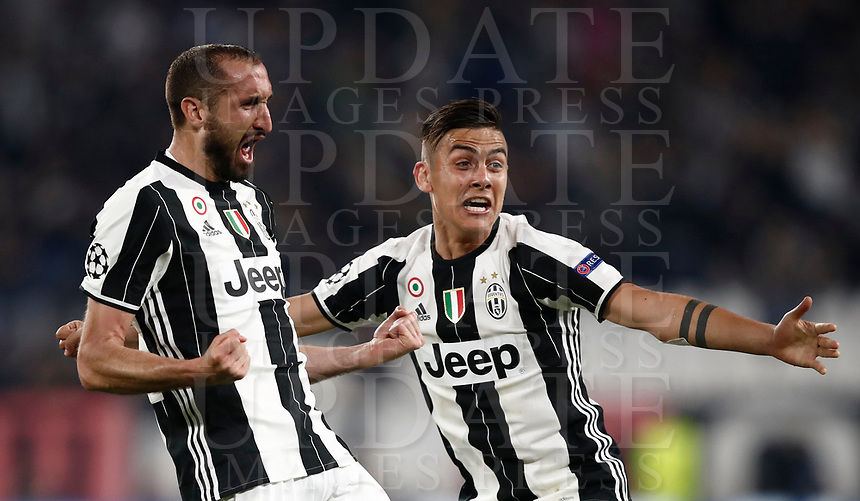 Football Soccer: UEFA Champions UEFA Champions League quarter final first leg Juventus-Barcellona, Juventus stadium, Turin, Italy, April 11, 2017. <br /> Juventus Giorgio Chiellini (l) celebrates with his teammate Paulo Dybala (r) after scoring during the Uefa Champions League football match between Juventus and Barcelona at the Juventus stadium, on April 11 ,2017.<br /> UPDATE IMAGES PRESS/Isabella Bonotto