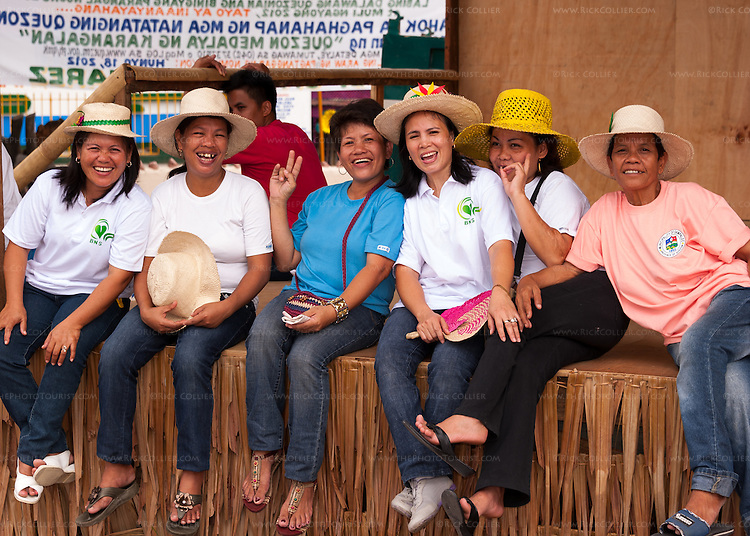 Almost everyone in Sampaloc turned out for the opening of the Bulihan Festival.  I found a line of friends (and weavers) resting in the shade of the podium.  (Sampaloc, Quezon Province, the Philippines.)