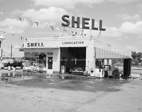 0301-329. Golden Shell Service Station, Wickenburg, Arizona. 1955. Gas station owned by Ben M. Crowder.