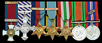 BNPS.co.uk (01202) 558833. <br /> Pic: DixNoonanWebb/BNPS<br /> <br /> Pictured: The medal set awarded to Group Captain Charles Kingcome. <br /> <br /> The medals of one of 'The Few' who survived bailing out of his Spitfire after being shot at 20,000ft have sold for £136,000 - triple their estimate.<br /> <br /> Group Captain Charles Kingcome officially claimed 11 kills during the Second World War but his actual tally is believed to have been far higher.<br /> <br /> He served at the Battle of France and the Dunkirk evacuation before becoming one of the most prolific pilots in the Battle of Britain.<br /> <br /> But he was nearly killed in October 1940 when a German Messerschmitt 109 plane raked his cockpit with bullets. He was tossed out of the cockpit like a 'rag doll in a hurricane' and parachuted rapidly towards the Kent countryside.