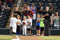 Fort Myers Miracle catcher Mitch Garver, flanked by umpires John Mang and Matt Winter, on field with baseball campers before a game against the Daytona Tortugas on June 18, 2015 at Hammond Stadium in Fort Myers, Florida.  Fort Myers defeated Daytona 4-1.  (Mike Janes/Four Seam Images)