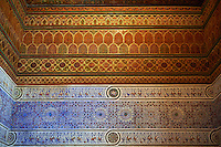Berber Arabesque decorative Zellige tiles and painted wood ceiling of Bou Ahmed's Harem. Bahia Palace, Marrakesh, Morroco