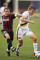 Richie Williams of the MetroStars and Sasha Victorine of the Galaxy battle for the ball. The LA Galaxy lost to the NY/NJ MetroStars 1-0 on 6/21/03 at Giant's Stadium, NJ.