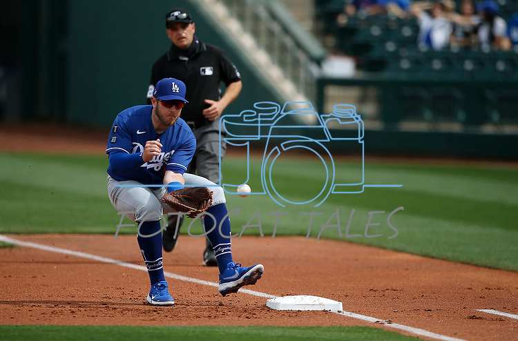 Max Muncy makes a play during a spring training game between the Texas Rangers and Los Angeles Dodgers in Surprise, Ariz., on Sunday, March 7, 2021.<br /> Photo by Cathleen Allison
