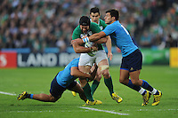 Sean O'Brien of Ireland is sandwiched between Simone Favaro and Tommaso Allan of Italy during Match 28 of the Rugby World Cup 2015 between Ireland and Italy - 04/10/2015 - Queen Elizabeth Olympic Park, London<br /> Mandatory Credit: Rob Munro/Stewart Communications