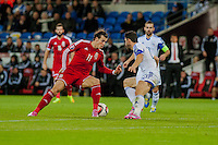 Wednesday 4th  December 2013 Pictured: Gareth Bale of Wales  gets the ball past Marios Nikolaou of Cyprus  <br /> Re: UEFA European Championship Wales v Cyprus at the Cardiff City Stadium, Cardiff, Wales, UK