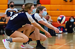 PLYMOUTH, CT-111020JS20 —Wolcott Tech's Zoe Orie (18) and Rachel Heaney (86)  both dig for the ball during their match against Terryville Tuesday at Terryville High School. <br /> Jim Shannon Republican-American