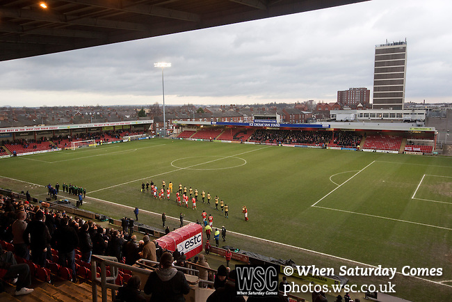 Crewe Alexandra 1 Leyton Orient 2, 18/01/2014. Gresty Road, League One. The two teams walking on to the pitch at the Alexandra Stadium on Gresty Road, Crewe, the home of Crewe Alexandra (in red) before their home game against Leyton Orient in the SkyBet League One. The match was won by the visitors from London by 2-1 with two goals on debut by Chris Dagnall, sending Orient to the top of the league. The match was watched by 4830 spectators. Photo by Colin McPherson.