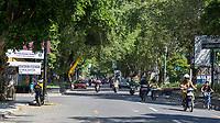 Yogyakarta, Java, Indonesia.  Tree-lined Street in Suburban Area.
