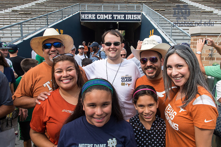 Sept. 4, 2015; Rev. Dan Ponisciak, C.S.C. visits the Notre Dame Stadium tunnel and field with parishioners from St. Ignatius Martyr in Austin, TX, a parish served primarily by the Congregation of Holy Cross. (Photo by Matt Cashore/University of Notre Dame)