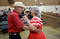 Clyde and Jewell Barnett, married for 64 years, dance Wednesday, June 10, 2021, to the music of the Southern Gentlemen inside the Springdale Senior Activity and Wellness Center. The center has resumed full activities and services. Check out nwaonline.com/210611Daily/ and nwadg.com/photos for a photo gallery.<br /> (NWA Democrat-Gazette/David Gottschalk)