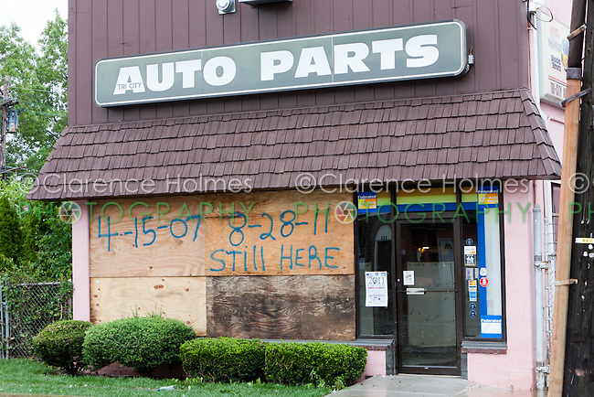 MAMARONECK, NY - AUGUST 28: A local business in the Village of Mamaroneck, New York, boarded-up to prevent storm damage, displays a message about surviving the Nor'easter of April 15, 2007 and Hurricane Irene.