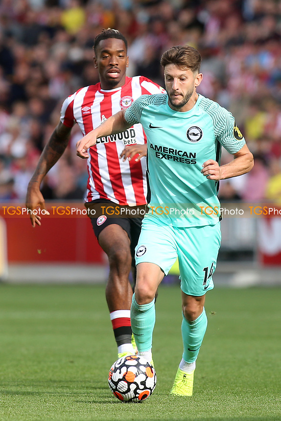 Adam Lallana of Brighton & Hove Albion in possession as Brentford's Ivan Toney looks on during Brentford vs Brighton & Hove Albion, Premier League Football at the Brentford Community Stadium on 11th September 2021