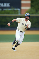 Michael Ludowig (22) of the Wake Forest Demon Deacons hustles towards third base against the Miami Hurricanes at David F. Couch Ballpark on May 11, 2019 in  Winston-Salem, North Carolina. The Hurricanes defeated the Demon Deacons 8-4. (Brian Westerholt/Four Seam Images)