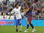 FC Barcelona's Carles Puyol (r) have words with Real Zaragoza's Leonardo Daniel Ponzio during La Liga match.October 23,2010. (ALTERPHOTOS/Acero)