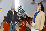 Albert Walsh & the Reverend Brian Rogers with one of the newly refurbished windows of St Michaels Church in Waterville.