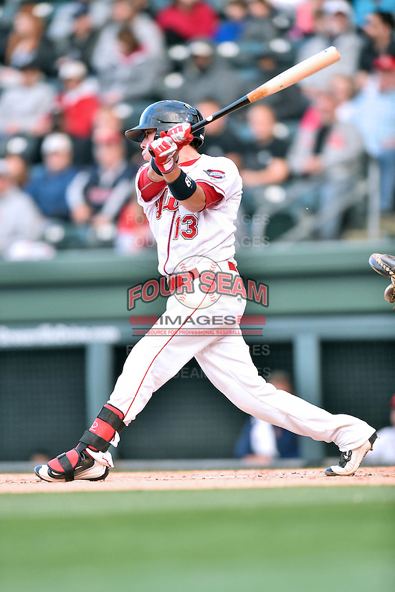 Greenville Drive catcher Austin Rei (13) swings at a pitch during a game against the  Asheville Tourists at Fluor Field on April 7, 2016 in Greenville South Carolina. The Drive defeated the Tourists 4-3. (Tony Farlow/Four Seam Images)