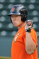 Catcher Eric Sim (16) of the Augusta GreenJackets, a San Francisco Giants affiliate, prior to a game against the Greenville Drive on April 19, 2012, at Fluor Field at the West End in Greenville, South Carolina. (Tom Priddy/Four Seam Images)