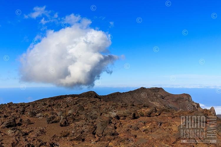 A lone cloud floats close to the Earth at Haleakala National Park, Maui.