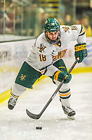 29 December 2014: University of Vermont Catamount Defenseman Alexx Privitera, a Junior from Old Tappan, NJ, on the offensive in the second period against the Providence College Friars in the deciding game of the annual TD Bank-Sheraton Catamount Cup Tournament at Gutterson Fieldhouse in Burlington, Vermont. The Friars shut out the Catamounts 3-0 to win the 2014 Cup. Mandatory Credit: Ed Wolfstein Photo *** RAW (NEF) Image File Available ***