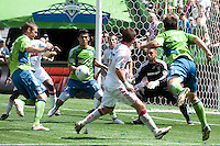 Nate Jaqua (l) and Fredy Montero (17) of the Seattle Sounders receive a header pass in the box from Patrick Ianni (r)  as Jon Busch (2r) and Gonzalo Segares (c) of the Chicago Fire defend in the match at the XBox Pitch at Quest Field on July 25, 2009. The Sounders and Fire played to a 0-0 draw.