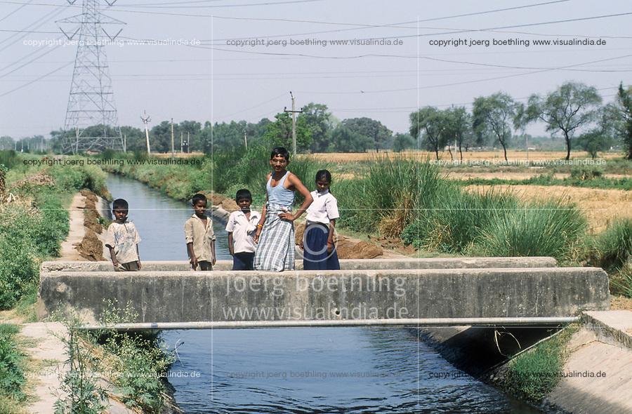 INDIA, Benares Varanasi,<br /> people on bridge of sewage canal
