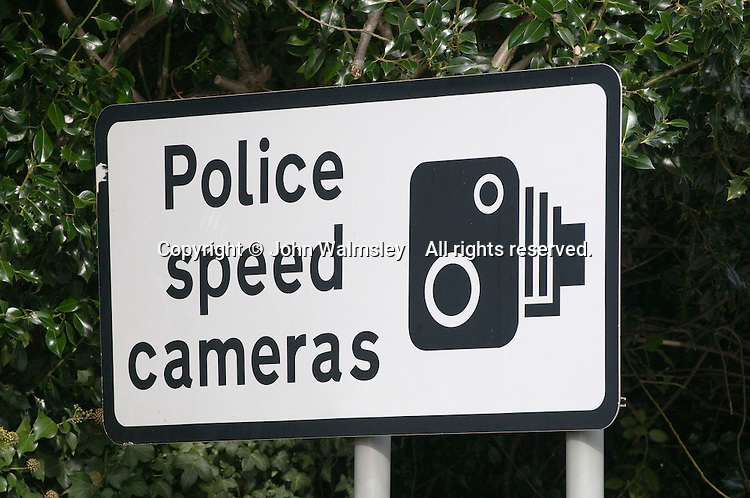 Warning sign for speed cameras ahead.