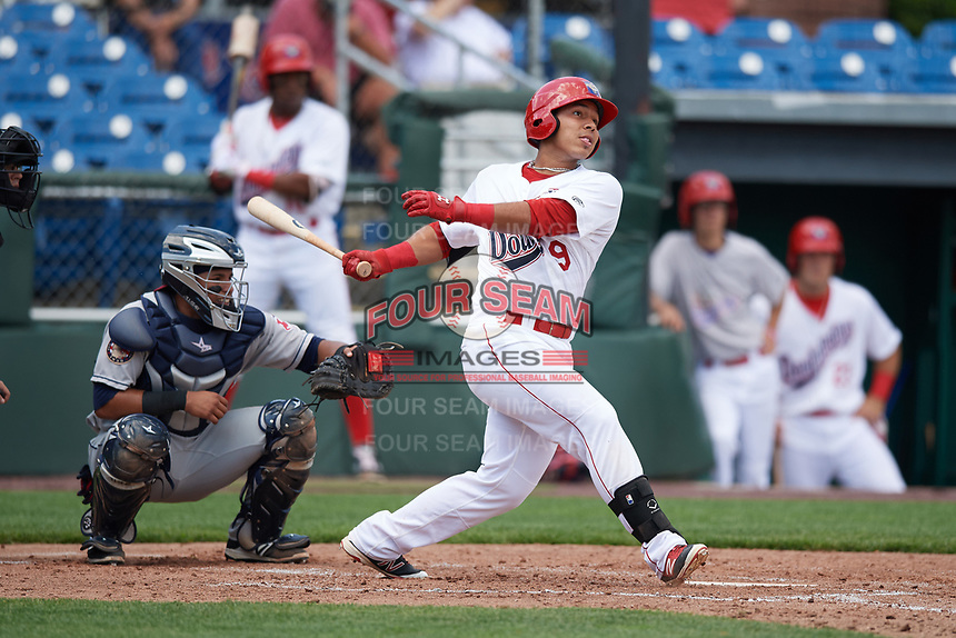 Auburn Doubledays left fielder Oliver Ortiz (9) at bat in front of catcher Gian Paul Gonzalez during the first game of a doubleheader against the Mahoning Valley Scrappers on July 2, 2017 at Falcon Park in Auburn, New York.  Mahoning Valley defeated Auburn 3-0.  (Mike Janes/Four Seam Images)