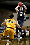 SIOUX FALLS, SD - MARCH 9: Carlos Jurgens #11 of the Oral Roberts Golden Eagles shoots over Jarius Cook #11 of the North Dakota State Bison during the 2021 Men's Summit League Basketball Championship at the Sanford Pentagon in Sioux Falls, SD. (Photo by Dave Eggen/Inertia)