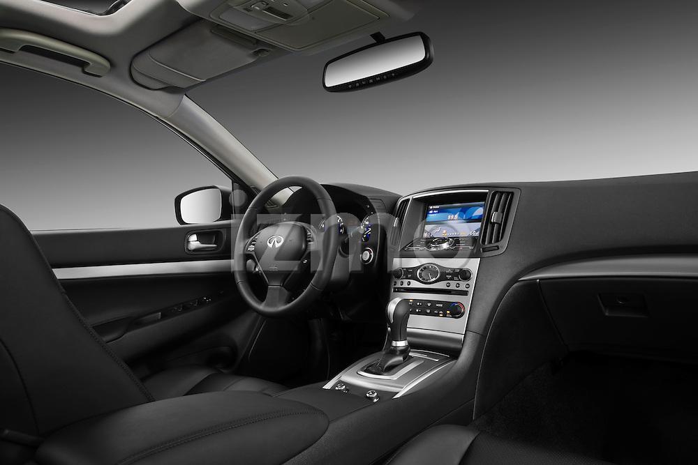 Passenger side dashboard view of a 2011 Infiniti G25 Journey Sedan.