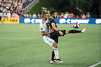 FOXBOROUGH, MA - AUGUST 4: Diego Rossi #9 of Los Angeles FC controls a high ball with Brandon Bye #15 of New England Revolution on attack during a game between Los Angeles FC and New England Revolution at Gillette Stadium on August 3, 2019 in Foxborough, Massachusetts.