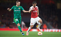 Dmytro Kravchenko of Vorskla Poltava & Henrikh Mkhitaryan of Arsenal during the UEFA Europa League match group between Arsenal and Vorskla Poltava at the Emirates Stadium, London, England on 20 September 2018. Photo by Andrew Aleks / PRiME Media Images.