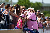 Fans take photos after the Cowboy Monkey Rodeo performed during a Wilmington Blue Rocks doubleheader against the Frederick Keys on May 14, 2017 at Daniel S. Frawley Stadium in Wilmington, Delaware.  Wilmington defeated Frederick 10-2.  (Mike Janes/Four Seam Images)