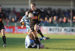 Jason Tovey gets away from Jamie Robinson. Newport Gwent Dragons V Cardiff Blues, Magners League.  © Ian Cook IJC Photography iancook@ijcphotography.co.uk www.ijcphotography.co.uk.