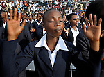 Just before the one-year anniversary of the January 2010 earthquake that ravaged Port-au-Prince, Haiti, this woman joined with thousands of others in the capital's soccer stadium for a religious gathering.