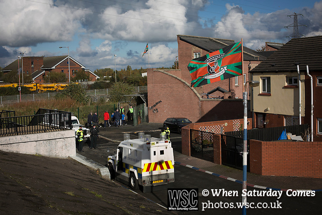 Glentoran 2 Cliftonville 1, 22/10/2016. The Oval, NIFL Premiership. Police Service of Northern Ireland officers on duty as away fans arrive at The Oval, Belfast before Glentoran hosted city-rivals Cliftonville in an NIFL Premiership match. Glentoran, formed in 1892, have been based at The Oval since their formation and are historically one of Northern Ireland's 'big two' football clubs. They had an unprecendentally bad start to the 2016-17 league campaign, but came from behind to win this fixture 2-1, watched by a crowd of 1872. Photo by Colin McPherson.