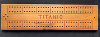 BNPS.co.uk (01202 558833)<br /> Pic: HAldridge/BNPS<br /> <br /> Smith also crafted a cribbage board from some Titanic driftwood.<br /> <br /> A poignant cross made from drift wood from the Titanic by a seaman tase with recovering the bodies from the disaster as surfaced 107 years later.<br /> <br /> The small religious symbol was delicately hand carved by Samuel Smith, a joiner on the cable-laying ship Minia which was tasked with searching for bodies.<br /> <br /> Mr Adams was so moved by the macabre experience that he honoured the victims by creating the wooden cross on a three-tiered plinth.<br /> <br /> He made it from a piece of oak wood he plucked from the ocean that has come from the sunken liner.