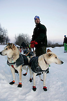 Wednesday March 7, 2007   ----  Oeyvind Skarsaune, a Norwegian high school student holds Ramey Smyth's dogs as Smyth checks in and out of Takotna on Wednesday evening.  Skarsaune is one of 12 high school students from Norway who are taking a month-long outdoor life class in Takotna.